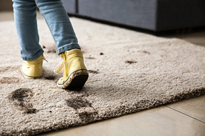 muddy shoes on the carpet, Kelly's Kleaning provides seasonal cleaning services and has some tip for keeping your home clean in the springtime.