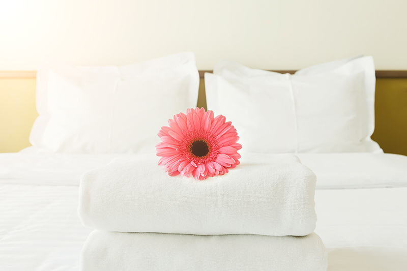 neatly made bed, Kelly's Kleaning LLC provides residential cleaning services to individuals in and around Ephrata PA, Elizabethtown PA, Sinking Spring PA and Wyomissing PA.
